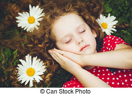 sweet-little-girl-sleeping-on-the-grass-with-chamomiles-stock-photograph_csp30125692